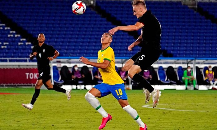 Germany defender Amos Pieper (5) heads the ball against Brazil forward Richarlison (10) during the first half in Group D play during the Tokyo 2020 Olympic Summer Games